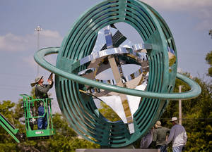 Photo - Crews put the final touches on the Compass Rose sculpture on Monday, Sept. 9, 2013 in Oklahoma City, Okla.  Photo by Chris Landsberger, The Oklahoman