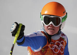 Photo - Italy's Verena Stuffer gestures in the finish area after completing a women's downhill training run at the Sochi 2014 Winter Olympics, Thursday, Feb. 6, 2014, in Krasnaya Polyana, Russia.  AP Photo/Gero Breloer)