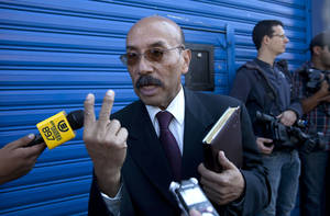 Photo - Telesforo Guerra, the lawyer of software company founder John McAfee, speaks to journalist outside the detention immigration center where McAfee is being held, in Guatemala City, Friday, Dec. 7, 2012.  Guerra told reporters that the creator of the McAfee antivirus program is in good health, and his team is filing four separate legal appeals in an effort to prevent his return to Belize. (AP Photo/Moises Castillo)