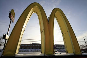 Photo - FILE  - This Tuesday, Jan. 21, 2014, file photo shows McDonald's restaurant's golden arches in Robinson Township, Pa. McDonald's reports quarterly earnings on Tuesday, April 22, 2014. (AP Photo/Gene J. Puskar, File)