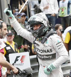 Photo - Mercedes driver Nico Rosberg, of Germany, celebrates after winning the Monaco Formula One Grand Prix at the Monaco racetrack, in Monaco, Sunday, May 25, 2014. (AP Photo/Antonio Calanni)
