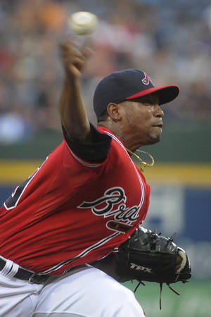 Photo - Atlanta Braves' Julio Teheran works against the Miami Marlins during the first inning of a baseball game, Friday, Aug. 30, 2013, in Atlanta. (AP Photo/John Amis)