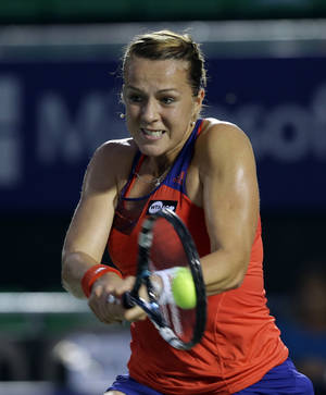 Photo - Anastasia Pavlyuchenkova of Russia returns a shot against Irina-Camelia Begu of Romania during the quarterfinal match of the Korea Open tennis championships in Seoul, South Korea, Friday, Sept. 20, 2013. (AP Photo/Lee Jin-man)