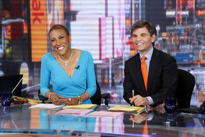 "Photo - This image released by ABC shows anchor Robin Roberts, left, and George Stephanopoulos during a broadcast of ""Good Morning America,"" Wednesday, Feb. 20, 2013 in New York.  Roberts returned to the popular morning program after undergoing a bone marrow transplant five months ago.  (AP Photo/ABC, Heidi Gutman)"