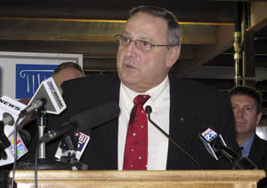 Photo - Maine Gov. Paul LePage outlines his plan to have the state repay nearly $500 million in hospital debt and release $105 million in voter-approved bonds on Tuesday, Jan. 15, 2013, in Portland, Maine. (AP Photo/Clarke Canfield)
