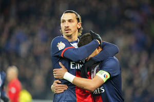 Photo - Paris Saint Germain's Zlatan Ibrahimovic of Sweden, left, congratulates Thiago Da Silva after he scored the opening goal during the League One soccer match between Paris Saint Germain and Nantes at the Parc des Princes stadium in Paris, Sunday Jan. 19, 2014. (AP Photo/Remy de la Mauviniere)