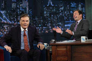 "Photo -   In this photo taken Thursday, July 26, 2012 and provided by NBCUniversal, actor Fred Willard, left, joins host Jimmy Fallon on the set of Fallon's NBC show ""Late Night,"" in New York. (AP Photo/NBCUniversal, Lloyd Bishop)"