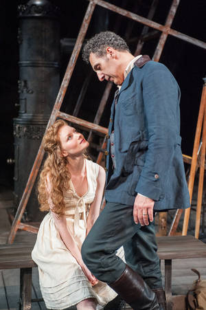 "Photo - This undated publicity image released by the Brooklyn Academy of Music shows Wrenn Schmidt, left, and John Turturro in a scene from Henrik Ibsen's ""The Master Builder,"" currently performing at the BAM Harvey Theater in  New York. (AP Photo/Brooklyn Academy of Music, Stephanie Berger)"