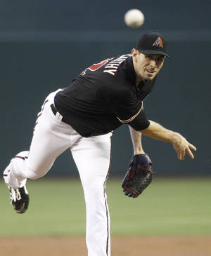 Photo - Arizona Diamondbacks' Brandon McCarthy delivers a pitch against the Cincinnati Reds' during the first inning of a baseball game on Saturday, May 31, 2014, in Phoenix. (AP Photo/Ralph Freso)