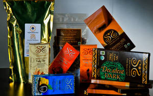 Photo - Products from Sibu Sura Chocolates, shown, are now available in Oklahoma at Akin's Natural Foods Market. <strong>CHRIS LANDSBERGER - THE OKLAHOMAN</strong>