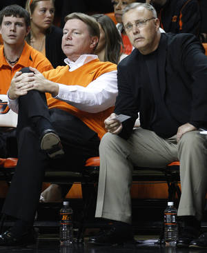 Photo - OSU women's coach Jim Littell, right, took over for Kurt Budke, left, after Budke and assistant coach Miranda Serna were killed in a plane crash Nov. 17, 2011.                    AP Photo