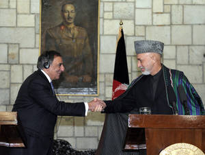 Photo - U.S. Defense Secretary Leon Panetta, left, shakes hands with Afghanistan President Hamid Karzai, right, during their joint press conference at the Presidential Palace in Kabul, Afghanistan, Thursday, Dec. 13, 2012. (AP Photo/Susan Walsh, Pool)