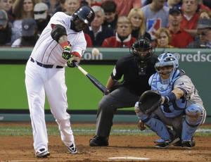 Photo - Boston Red Sox's David Ortiz hits a solo home run off Tampa Bay Rays starting pitcher David Price in front of Rays catcher Jose Molina during the first inning in Game 2 of baseball's American League division series, Saturday, Oct. 5, 2013, in Boston. (AP Photo/Stephan Savoia)