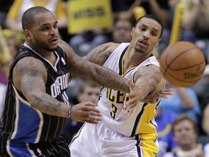 Photo -   iIndiana Pacers guard George Hill, right, defends Orlando Magic forward Glen Davis during the second half of Game 5 of an NBA basketball first-round playoff series, in Indianapolis on Tuesday, May 8, 2012. The Pacers defeated the Magic 105-87 to win the series 4-1. (AP Photo/Michael Conroy)