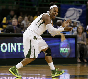 Photo - Baylor guard Odyssey Sims celebrates a score against California late in the second half of a second-round game in the NCAA women's college basketball tournament, Monday, March 24, 2014, in Waco, Texas. Baylor won 75-56. (AP Photo/Tony Gutierrez)