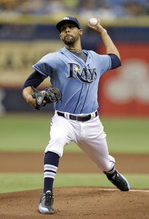 Photo - Tampa Bay Rays starting pitcher David Price delivers to the Pittsburgh Pirates during the first inning of an interleague baseball game Wednesday, June 25, 2014, in St. Petersburg, Fla. (AP Photo/Chris O'Meara)