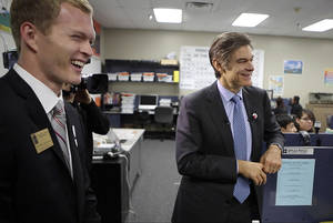 photo - Dr. Mehmet Oz, right, visits a classroom at ASTEC Charter Schools with HealthCorps coordinator Ryan Fightmaster in Oklahoma City.