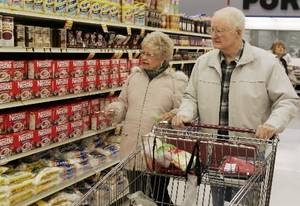 Photo - Winnie and George Hall shop for groceries in Edmond, Okla., Thursday, Jan. 29, 2009.  Oklahoma's grocery tax credit would be expanded under a proposal to be considered by the state Legislature. (AP Photo)