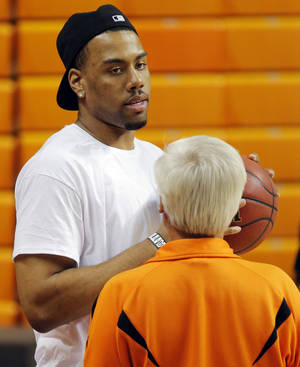Photo - COLLEGE BASKETBALL: Former OSU basketball player Darrell Williams talks with Tom Dirato, former OSU broadcaster, before men's basketball practice for the Oklahoma State University Cowboys at Gallagher-Iba Arena in Stillwater, Okla., Monday, Oct. 22, 2012. Photo by Nate Billings, The Oklahoman