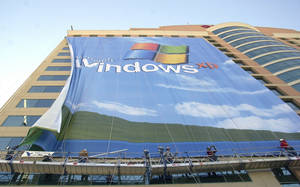 Photo -  Workers install a 10-story Windows XP banner in November 2011 on a hotel near the Las Vegas Convention Center in Las Vegas. AP Photo  <strong>Joe Cavaretta -   </strong>