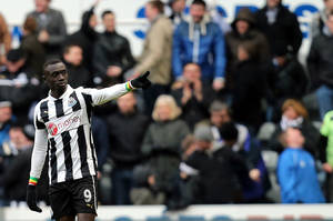 photo - Newcastle United's Papiss Cisse celebrates his goal during their English Premier League soccer match against Stoke City at St James' Park, Newcastle, England, Sunday, March 10, 2013. (AP Photo/Scott Heppell)