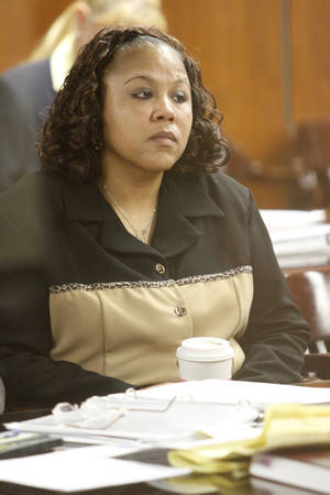 Photo - Dionne A. McKinney listens to testimony during her civil trial against Oklahoma County Sheriff John Whetsel.