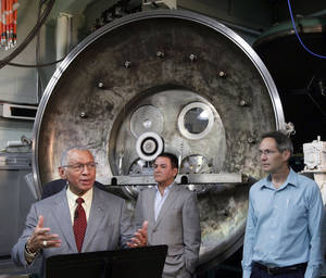 Photo - NASA Administrator Charles Bolden, left to right, Firouz Naderi, Director for the Solar System Exploration, and John Brophy, Electric Propulsion Engineer, are shown during Bolden's visit to the Jet Propulsion Laboratory in Pasadena, Calif., on Thursday, May 23, 2013. NASA engineers are developing an ion engine  for an asteroid capture mission later this decade. (AP Photo/Nick Ut)