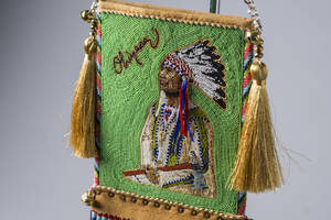 Photo - ?Looking Forward, Looking Back-Mirror Bag,? beadwork/quillwork, by Orlando Dugi and Kenneth Williams was selected Best of Show during the seventh annual Cherokee Art Market awards reception with $75,000 in overallprize money awarded across 20 categories held on Friday, Oct. 12, 2012, at Hard Rock Hotel & Casino Tulsa in Catoosa, Okla. The Cherokee Art Market features more than 130 elite Native American artists from across the nation. The finest Native American artwork representing more than 45 different tribes is on display and sale, including beadwork, pottery, painting, basketry, sculptures and textiles. <strong>Jeremy Charles</strong>
