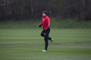 Photo - Manchester United's Wayne Rooney trains with teammates at Carrington training ground in Manchester, Monday, Feb. 24, 2014. Manchester United will play Olympiakos in a Champions League first knockout round on Tuesday. (AP Photo/Jon Super)
