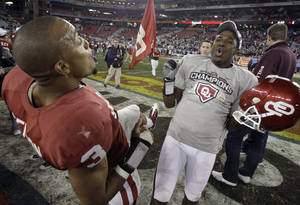 Photo - Oklahoma players Jonathan Nelson, left, and Javon Harris celebrate after defeating Connecticut in the Fiesta Bowl  NCAA football game Saturday, Jan. 1, 2011, in Glendale, Ariz. Oklahoma won 48-20. (AP Photo/Paul Connors)