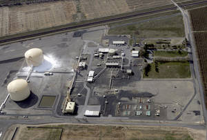 Photo - In this aerial photo, the Williams Northwest Pipeline plant is seen after a large explosion and fire in Plymouth, Wash., Monday, March 31, 2014. Benton County Sheriff Steven Keane said some gas leaked from the tank to the ground in a containment area and evaporated into the air, but it was only a small amount. (AP Photo/The Tri-City Herald, Sarah Gordon)