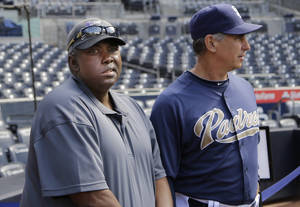 Photo - In this June 11, 2013, photo, Hall-of-Fame baseball player Tony Gwynn, left, watches with Padres manager Bud Black as Padres players prepare for a baseball game in San Diego. Gwynn remains in the thoughts of his San Diego State Aztecs, who have reached the NCAA regionals for the second straight season. Gwynn has been on a medical leave of absence since late March. (AP Photo/Lenny Ignelzi)