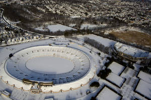 photo - The Yale Bowl in New Haven, Connecticut, is blanketed in snow Sunday, Feb. 10, 2013, in the aftermath of a storm that hit Connecticut and much of the New England states. (AP Photo/Craig Ruttle)