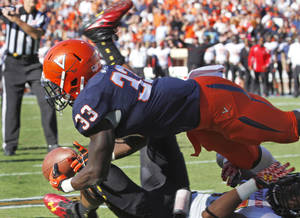 Photo -   Virginia running back Perry Jones (33) dives for the ball in the end zone over Maryland defensive back Anthony Nixon during the first half of an NCAA college football game in Charlottesville, Va., Saturday, Oct. 13, 2012. The pass was incomplete. (AP Photo/Steve Helber)