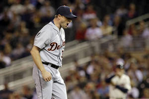 Photo - Detroit Tigers pitcher Max Scherzer reacts after he struck out Minnesota Twins' Josmil Pinto to end the first inning of a baseball game, Wednesday, Sept. 25, 2013, in Minneapolis. (AP Photo/Jim Mone)