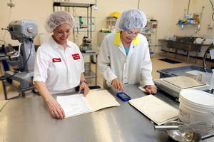 photo - Vanessa Pry (left) and Renee Alberson-Nelson work in the baking lab at Oklahoma State University's Robert M. Kerr Food & Agricultural Products Center. The two were developing a Shawnee Mills product to be used by Taco Mayo. <strong>PAUL HELLSTERN - The Oklahoman</strong>