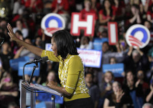Photo -   First lady Michelle Obama campaigns for her husband, President Barack Obama, Monday, Oct. 15, 2012, at Ohio Wesleyan University in Delaware, Ohio. (AP Photo/Jay LaPrete)
