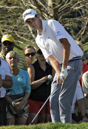 Photo - Chesson Hadley chips onto the 16th green during the third round of the Arnold Palmer Invitational golf tournament at Bay Hill, Saturday, March 22, 2014, in Orlando, Fla. (AP Photo/Chris O'Meara)