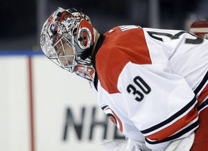 Photo - Carolina Hurricanes goalie Cam Ward looks down after New York Rangers' Benoit Pouliot scored during the second period of an NHL hockey game Tuesday, April 8, 2014, in New York. (AP Photo/Frank Franklin II)