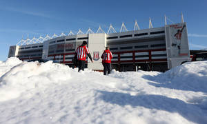 photo - Stoke City fans make their way through the snow ahead of the English FA Cup fourth round soccer match against Manchester City at the Britannia Stadium in Stoke on Trent, England, Saturday Jan. 26, 2013. (AP Photo/Dave Thompson, PA) UNITED KINGDOM OUT: NO SALES: NO ARCHIVE: