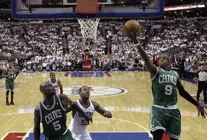 Photo -   Boston Celtics guard Rajon Rondo (9) shoots as Celtics forward Kevin Garnett (5) and Philadelphia 76ers forward Lavoy Allen (50) wait under the basket in the first half of Game 4 of an NBA basketball Eastern Conference semifinal playoff series on Friday, May 18, 2012, in Philadelphia. (AP Photo/Alex Brandon)