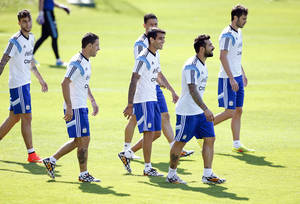Photo - Argentine players walk during a training session in Vespesiano, near Belo Horizonte, Brazil, Sunday, June 22, 2014.  Argentina plays in group F of the 2014 soccer World Cup. (AP Photo/Victor R. Caivano)