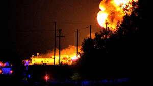 Photo - In this image from video, a fire burns at Danlin Industries late Wednesday, Sept 18, 2013 near Thomas, Okla. The plant produces chemicals for the oil and gas industry. No injuries were reported. (AP Photo/KWTV News 9)