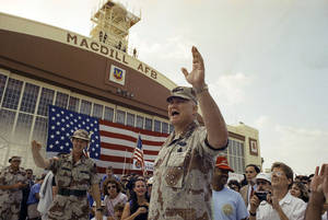 Photo - FILE - In this April 22, 1991 file photo, General H. Norman Schwarzkopf waves to the crowd after a military band played a song in his honor at welcome home ceremonies at MacDill Air Force Base in Tampa, Fla. Schwarzkopf died Thursday, Dec. 27, 2012 in Tampa, Fla. He was 78. (AP Photo/Lynne Sladky, File)