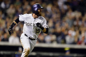 Photo - Colorado Rockies' Charlie Blackmon watches the flight of a solo home run against the New York Mets during the seventh inning of a baseball game, Friday, May 2, 2014, in Denver. (AP Photo/Jack Dempsey)