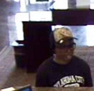 Photo -  Surveillance photo of female bank robber.  <strong> -  Photo provided </strong>
