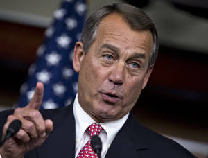 "photo - House Speaker John Boehner of Ohio gestures during a news conference on Capitol Hill in Washington, Thursday, Dec. 13, 2012, where he accused President Barack Obama of not being serious about cutting government spending. Boehner is insisting that Obama wants far more in tax increases than spending reductions and appears willing to walk the economy ""right up to the fiscal cliff.""   (AP Photo/J. Scott Applewhite)"