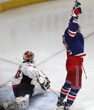 Photo -   New York Rangers center Artem Anisimov, right, celebrates after Marc Staal's overtime goal slid past Washington Capitals goalie Braden Holtby to give the Rangers a 3-2 victory over in Game 5 of the NHL hockey Stanley Cup Eastern Conference semifinals, at Madison Square Garden in New York, Monday, May 7, 2012. (AP Photo/Kathy Willens)