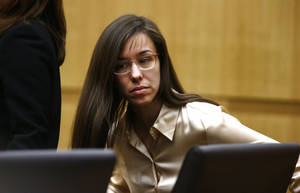 Photo - Jodi Arias appears for the sentencing phase of her trial at Maricopa County Superior Court in Phoenix, Wednesday, May 15, 2013. The same jury that convicted Arias of murder one week ago took about three hours Wednesday to determine that the former waitress is eligible for the death penalty in the stabbing and shooting death of her one-time lover in his bathroom five years ago. (AP Photo/The Arizona Republic, Rob Schumacher, Pool)