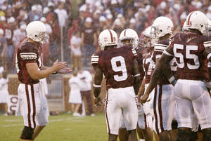 Photo - OU COLLEGE FOOTBALL: Oklahoma University vs North Texas University at Gaylord Family - Oklahoma Memorial Stadium August 30, 2003. Quarterback Jason White addresses the huddle in the first quarter. Staff photo by Doug Hoke.